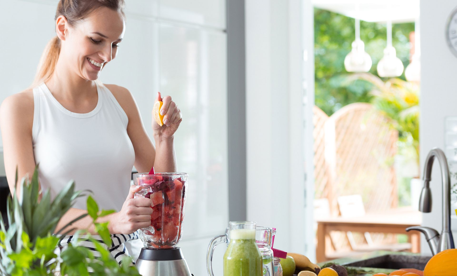 active slim image of woman making a smoothie